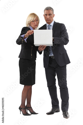 businessman and lady with laptop