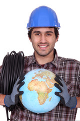 Electrician with a globe in his hands