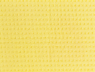 texture of yellow sponges for washing and cleaning