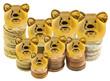 tirelires dorées sur empilement de pièces d'euros