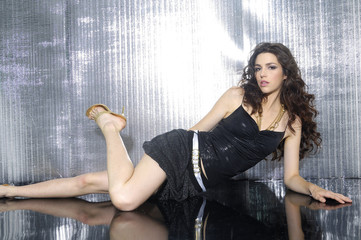 Fashion style photo of beautiful lady laying on the floor