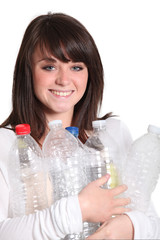 Brunette recycling plastic bottles