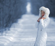 The woman in the winter white clothes