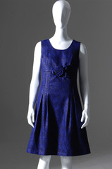 female fashion black dress on mannequin a gray