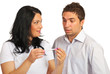 Surprised couple holding pregnancy test