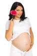 Beauty future mother holding flower