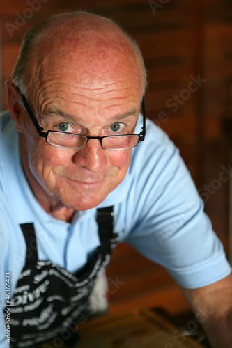 senior man wearing an apron