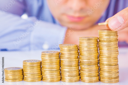 A Businessman rising coins