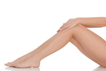 Beautiful female legs and hands, isolated on white