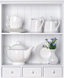 White shelf with vintage porcelain tableware