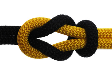academic knot of black and yellow rope