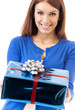 Cheerful woman showing gift, over white