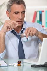 Businessman taking his medication