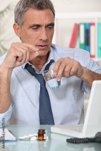 Businessman taking his medication