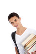 Smiling teenage boy carrying books