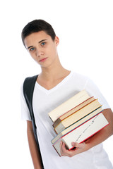 Serious teenaged boy with textbooks