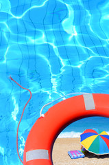 Life preserver in the pool with a beach photograph