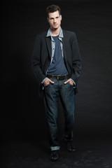 Handsome man dark winter fashion. Studio shot.