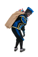 Dutch black pete with many presents in jute bag
