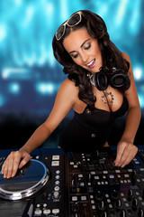 Sexy curvy DJ mixing music