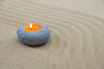 Sand und Kerze