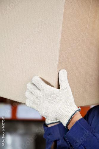 Foreman's Hands Lifting Cardboard Box