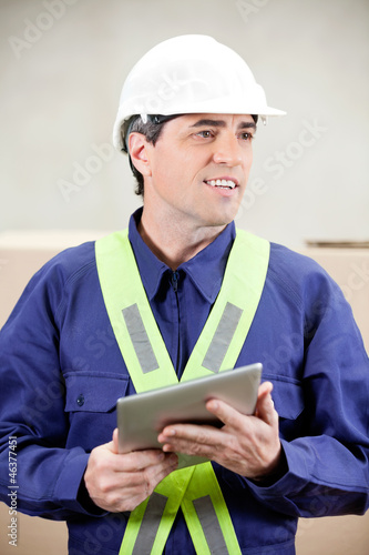 Foreman With Digital Tablet Standing in Warehouse