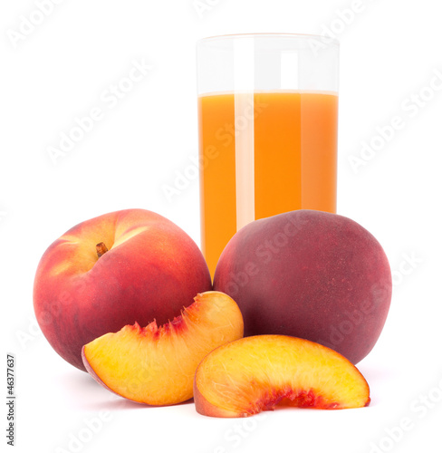 Ripe peach fruit and juice glass