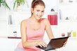 woman smiling while working on laptop