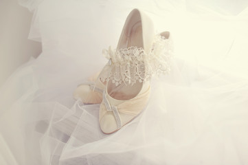 White shoes of the bride on a white background