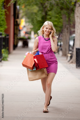 Attractive Blond Woman Walking Down Street