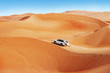 Leinwanddruck Bild - 4 by 4 dune bashing is a popular sport of the Arabian desert