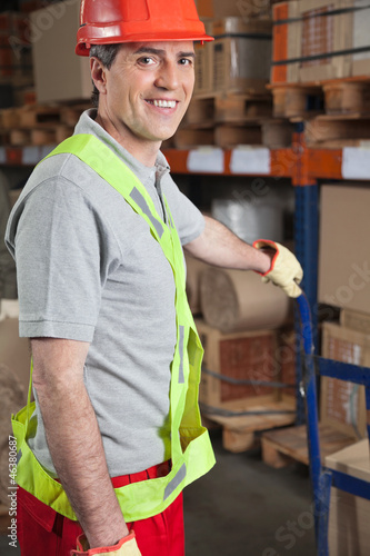 Foreman Holding Handtruck At Warehouse