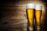 Two glass beer on wood background with copyspace