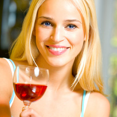Young woman with glass of red wine