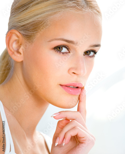 Beautiful blond woman with finger on lips
