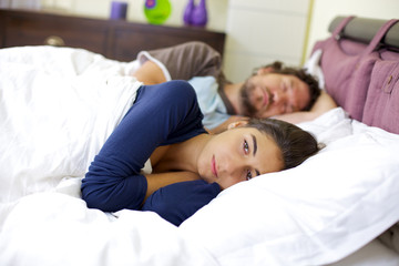 Crying woman in bed problems in relationship