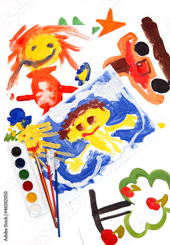 collage of children's drawings, watercolors and brushes