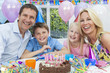 Family Celebrating Children's Birthday Party With Cake