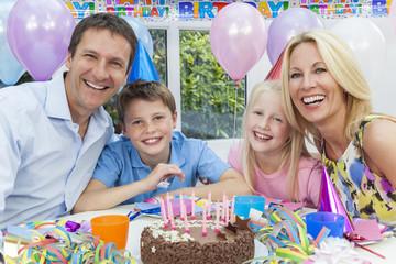Family Celebrating Children's Birthday Party With Cake