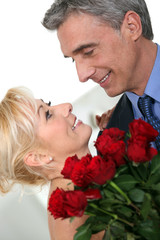 Romantic couple with red roses