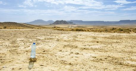 Bottle of water in Desert of the Bardenas Reales in Navarre