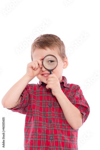 canvas print picture kleiner Junge auf der Suche mit Lupe