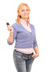 Smiling mature female holding a car key