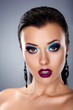 Holiday evening make up. Stylish beauty young woman face