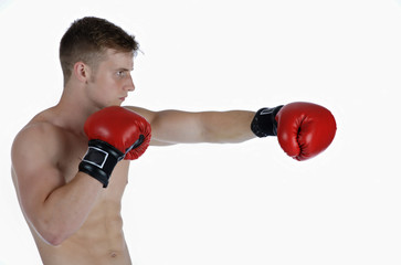 Young male athlete warming up with boxing gloves