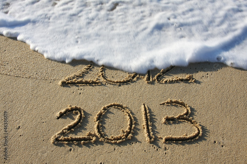 2013 with a wave washing away 2012