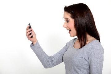young woman receiving good news on her cell