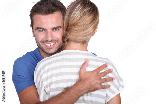 Man hugging his girlfriend