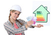 Construction worker with cash and an energy rating card